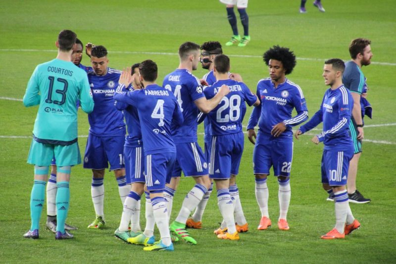 Chelsea players celebrating a win