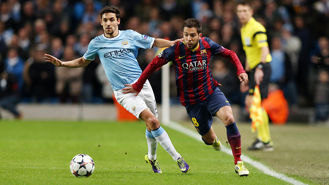 Two players running on the pitch