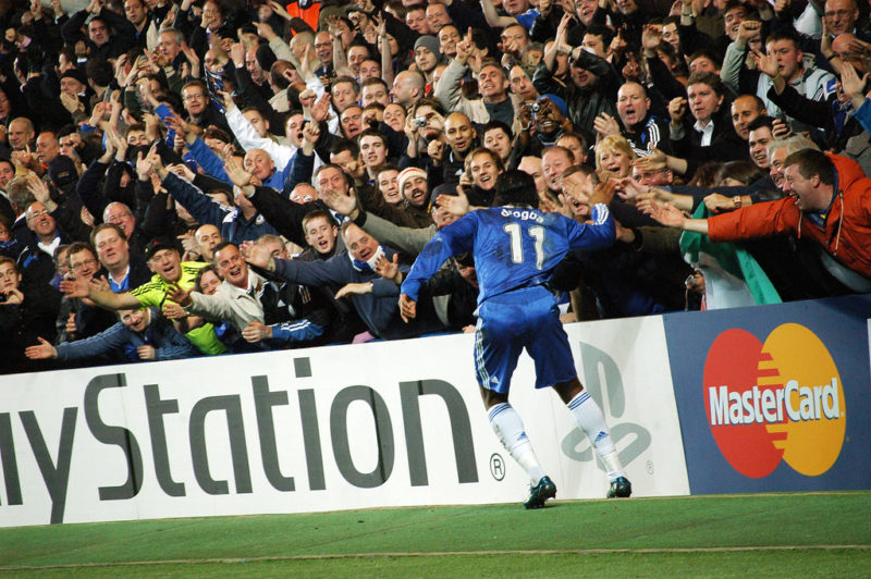 A player celebrating a goal with the fans