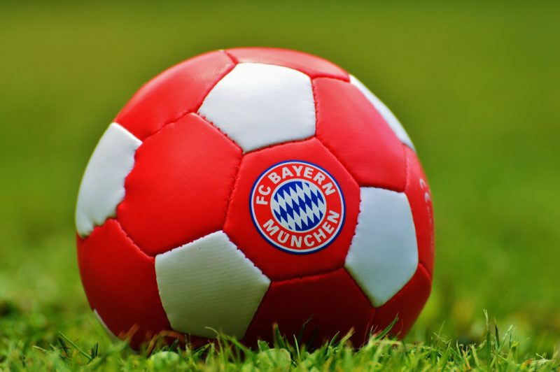 A football with Bayern logo on grass