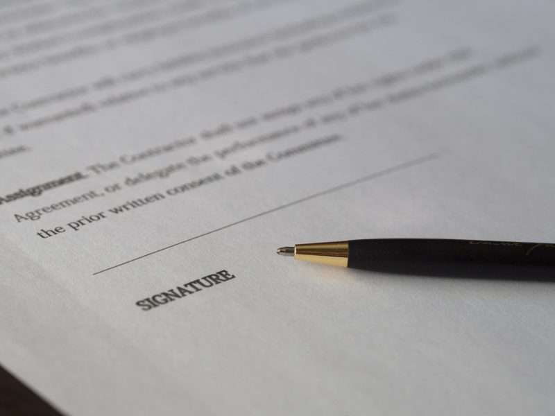 An unsigned contract with a pen