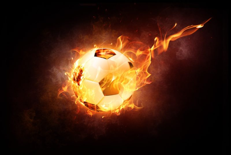 Football on fire with black background