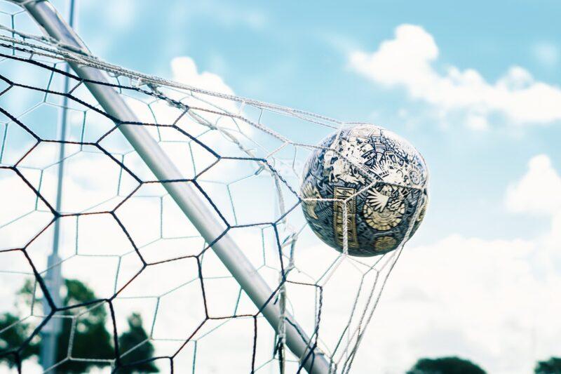 A football hitting the net